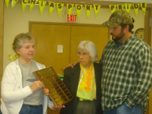 Barbara Maloy and Lois Sprague presenting the Boston Post Cane Plaque  listing all of those who have received the Boston Post Cane. The Plaque was presented to Selectman Charles Ingalls.